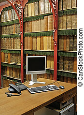 library interior - antique library with modern computer