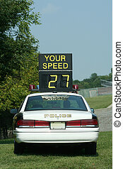 Police Car Speed Check - A Police Car Speed Check against...