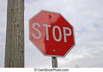 Stop Sign - An angled upward view of a stop sign beside a...
