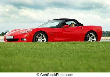 corvette_02 - red corvette car on the road with green grass...