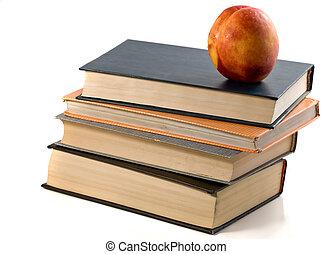 books and nectarine isolated white