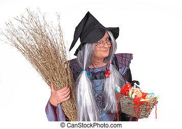 Trick or treat, halloween - Halloween witch offering candy,...