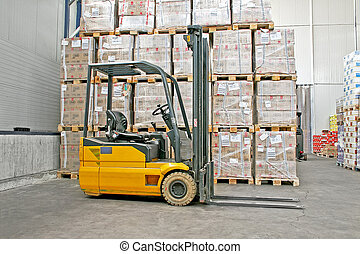Forklifter industry - Yellow fork lifter truck and cargo...