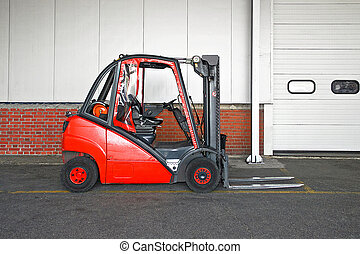 Red forklifter - Big red fork lifter truck in storehouse