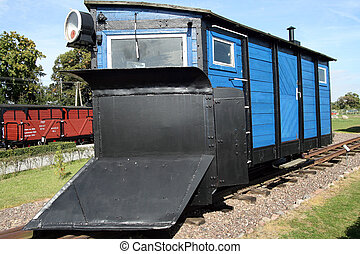 Train carriage with plough in front