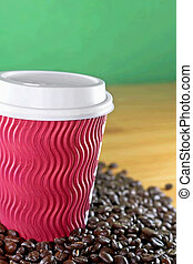 Take away coffee cup with roasted coffee background