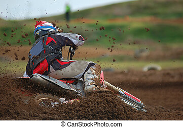 Motocross Rider - Motocross rider hitting the corner hard