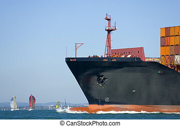 Container Ship - A huge container ship makes its way through...