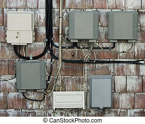 Utility Boxes and Wires - A grouping of gray and white...