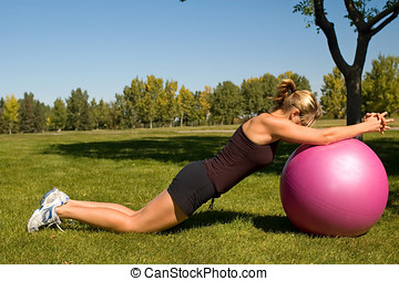 Ab Roll - Young woman performing an ab roll