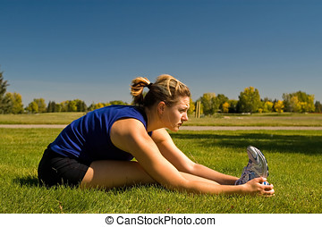 Seated Hamstring Stretch - Woman stretching her hamstrings