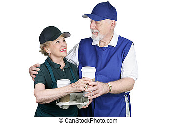 Coffee Break at Work - A senior couple enjoying a work break...