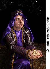Wiseman bearing gift of frankincense - Wise man arrayed in...
