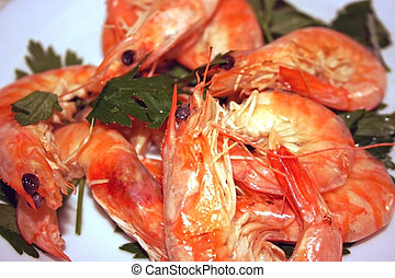 Shrimps with parsley - Cooked shrims with parsley on a white...