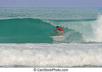 Glassy Barrel - A surfer gets barreled in a perfect glassy...