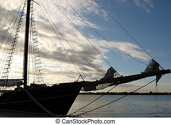 Old sailing ship - An old sailing ship backlighted at the...
