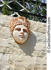 Statuette - Greek girl statuette on the garden wall.