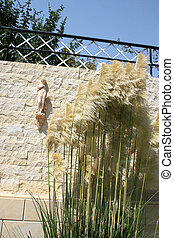 Statuette - Reed feather at the garden wall with greek girl...