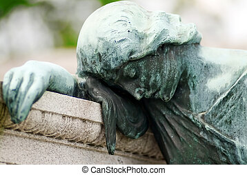 Grief Stricken - Tomb with a bronze statue of a grieving...