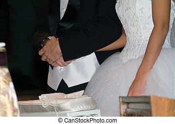 Wedding hands - Holding hands at the alter during wedding