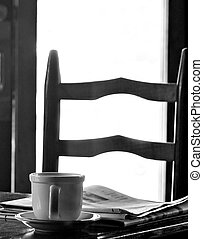 Morning coffee - Coffee cup and newspaper on a table with a...
