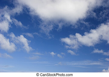 Cloudscape - Picture of a beautiful blue sky with white...