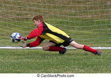 Goalkeeper protecting the net