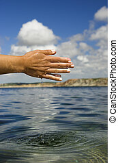 Feeling the water - Close up of woman hands catching water...