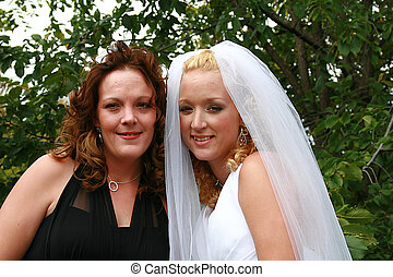 bride with friend - Beautiful bride and her best friend.