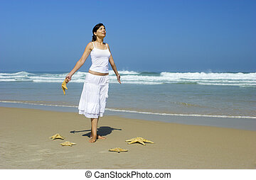 Starfish woman - Beautiful woman feeling the breeze with a...