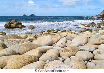 Porth Nanven beach - Large round stones on Porth Nanven...