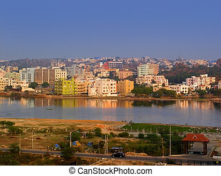 Indian Cityscape - Residential buildings by the lake in an...