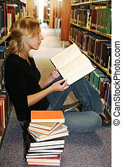 girl reading in the library - Beautiful young woman sitting...
