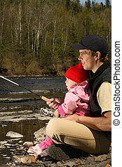 dad and daughter fishing - young father teaching his excited...