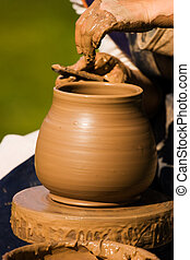 Traditional pottery - Potters hands creating a traditional...