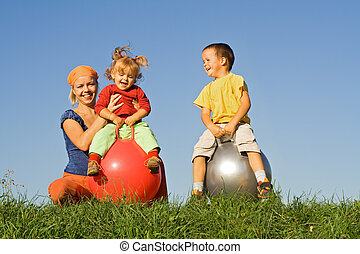 Family outdoors playing