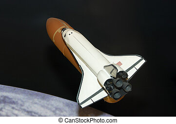 Space shuttle - A modle of the space shuttle with the earth...
