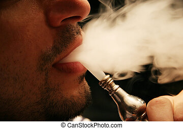 Smoking hookah - The mouth of a Syrian man smoking the...