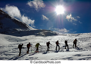 BACKCOUNTRY SKIERS - Group of backcountry skiers ski...