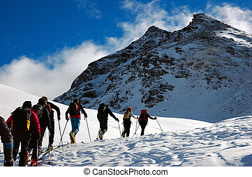 BACKCOUNTRY SKIERS - Group of backcountry skiers (ski...