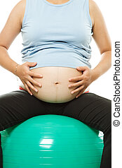 Pregnant woman exercising - An isolated shot of a pregnant...
