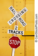 Railroad Crossing - Railroad crossing stop sign against a...