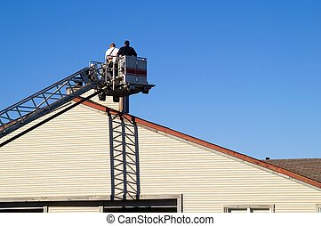 Chimney inspection - Firefighters on ladder performing...