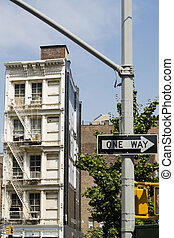 One way - Building and one way sign in the foreground.