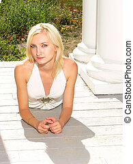 Young lady in an white bl - An young lady in short jeans and...