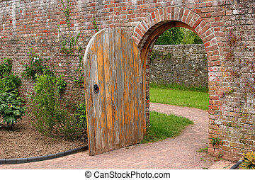 The Old Oak Door - Old open arched wooden door set into an...