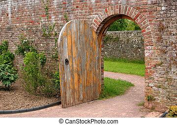 The Old Oak Door - Old open arched wooden door set into an...