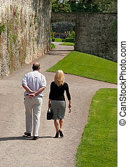 Leisurely Stroll - Man and a woman walking together on a...