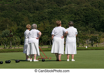 Ladies Who Bowl - Four elderly females rear view dressed in...