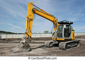 Digger - Industrial yellow digger standing idle on a...
